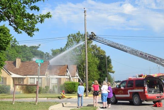 Bowie, Texas, firefighters battled a large house fire at the corner of Rock and Wise Saturday afternoon where the attic blaze essentially burned the roof off of the home. Eighth-grader Gracie Vahle responded quickly to the danger by making sure her elderly neighbor was OK.