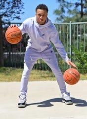 Jordan Montgomery shoots baskets on a half court in his backyard in Murrietta, California.