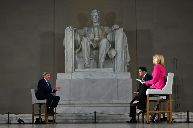 "President Donald Trump speaks during a Fox News virtual town hall ""America Together: Returning to Work,"" event, with anchors Bret Baier and Martha MacCallum, from the Lincoln Memorial in Washington, DC on May 3, 2020."