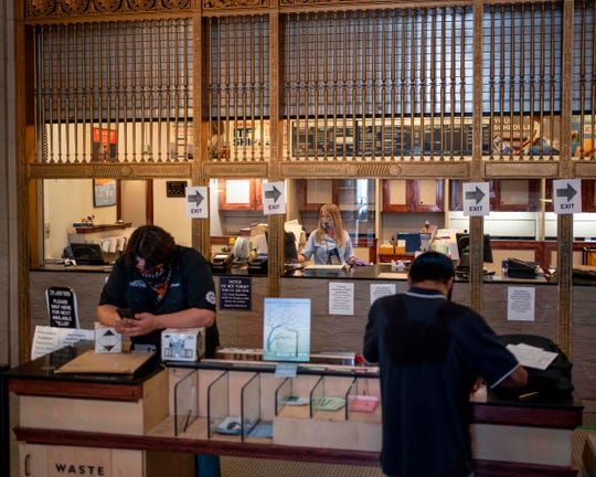 Customers prepare packages at a post office in downtown El Paso, Texas.