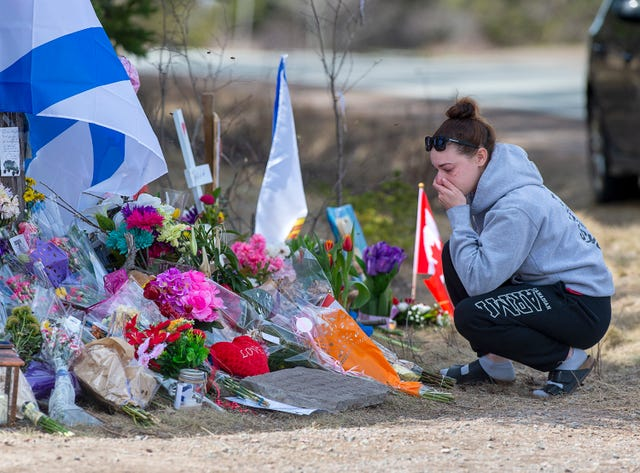 A woman pays her respects to the victims of a mass shooting in Portapique, Nova Scotia, on April 24, 2020.