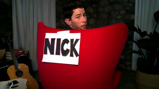 'The Voice' coach Nick Jonas does the best he can to re-create the studio at home during Monday's remote edition of the NBC singing competition.