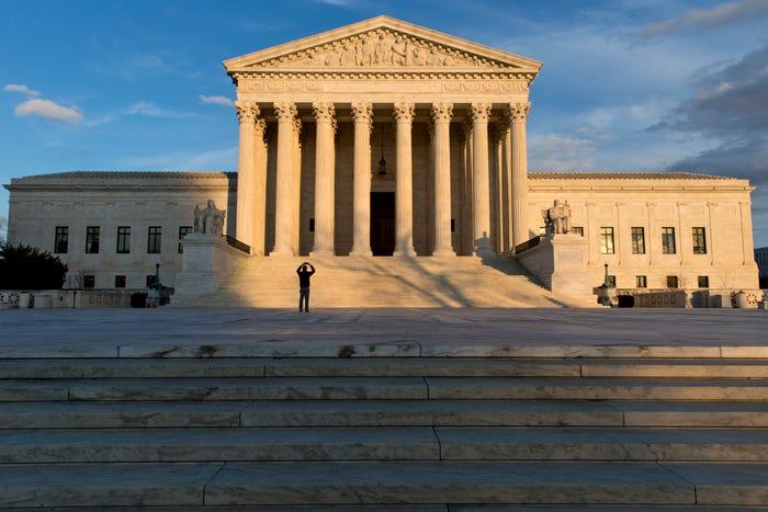Supreme Court debates HIV/AIDS pandemic while sheltering from coronavirus pandemic