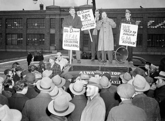 Walter Reuther, vice president of the United Auto Workers union, speaks to pickets grouped around the sound truck in front of the Chevrolet Gear and Axle Plant in Detroit, Mich., Nov. 23, 1945.