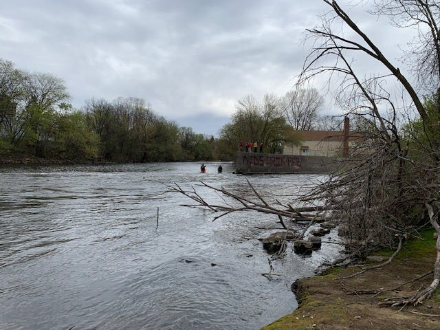 Divers from ALURT (Area Law Enforcement Underwater Recovery Team) search for a missing Olivet man in the Kalamazoo River.