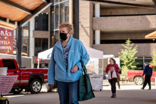 """The Battle Creek Farmers Market opens with social distancing protocols at Festival Market Square on Wednesday, May 6, 2020. Under Gov. Whitmer's executive order, farmers markets are designated """"essential."""""""