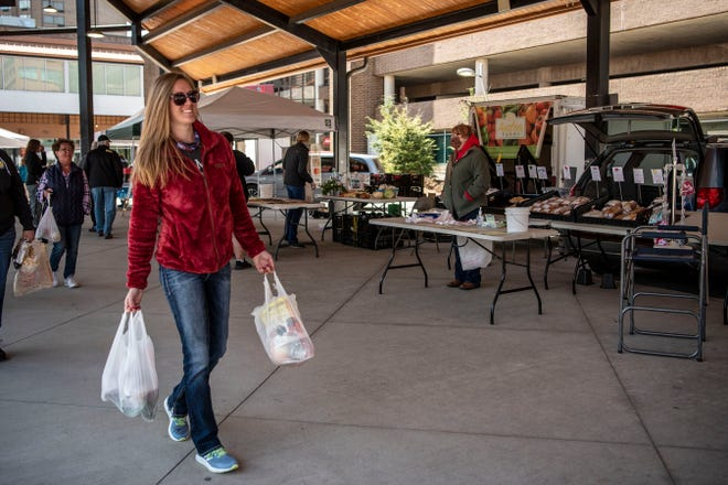 This photo from May 6, 2020 shows the first day of the Battle Creek Farmers Market season at Festival Market Square. The 2021 market season begins Wednesday with relaxed COVID-19 protocols, including voluntary mask wearing.