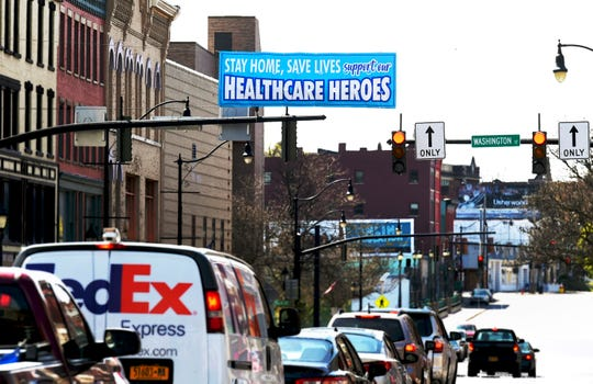 A sign honoring healthcare workers in downtown Binghamton on Tuesday, May 5, 2020.