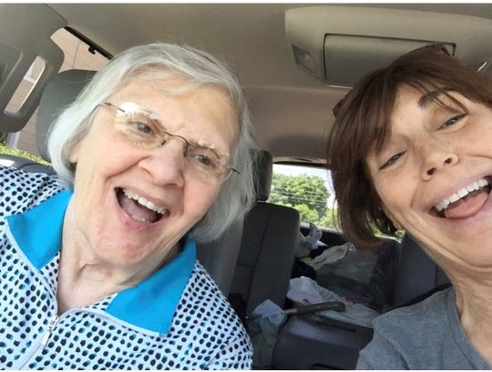 Fran Davis (left) and her daughter, Lisa France (right), after a 15-hour road trip.