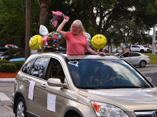 Sherri Liggett waves to her mother, Eleonor Larsen, a resident in the rehab section of Solaris HealthCare, during a parking lot parade at the facility Wednesday. Residents who can't have visits during the coronavirus crisis could see and hear their loved ones from a distance.
