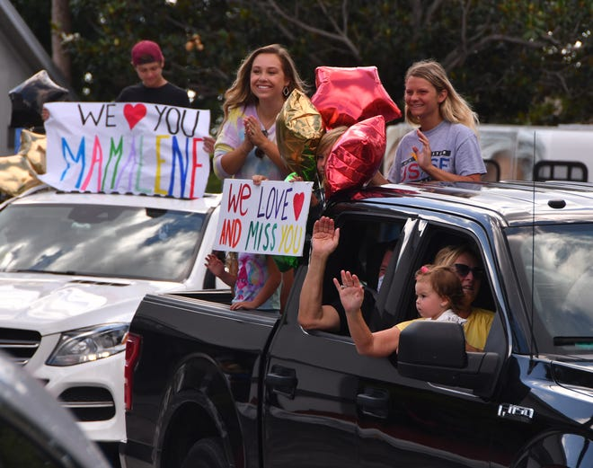 Family members of all ages were part of a parking lot parade Wednesday at Solaris HealthCare on Merritt Island, allowing residents who can't have visits during the coronavirus crisis to see and hear their loved ones from a distance.