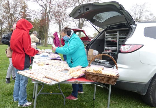Marci Teynor, right, sells her baked goods Tuesday at the Crestline Farmers Market.