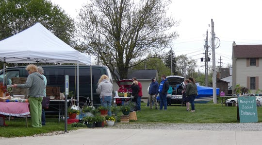 With face masks, hand sanitizer and disinfectant wipes at the ready, the Crestline Farmers Market opened its season Tuesday in a lawn next to the Crestline United Methodist Church.