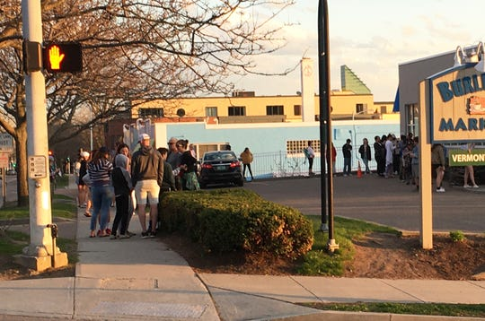 Small groups gather in the ice-cream line at Burlington Bay in Burlington on May 3, 2020.