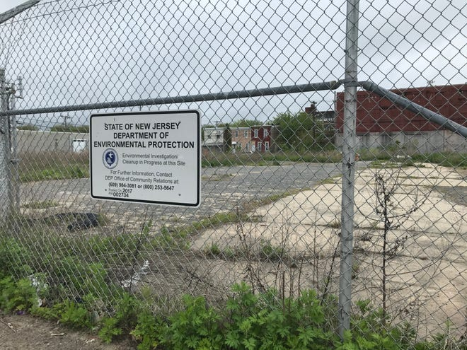 A fence surrounds a brownfield site on Federal Street in Camden.