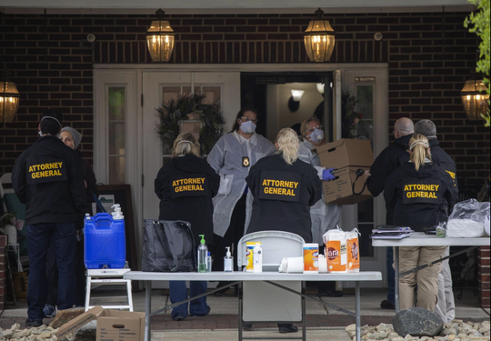 Staff of the Ohio Attorney General's office leave with boxes after conducting a search of Bickford assisted living and  memory care center in Worthington on Tuesday, May 5.