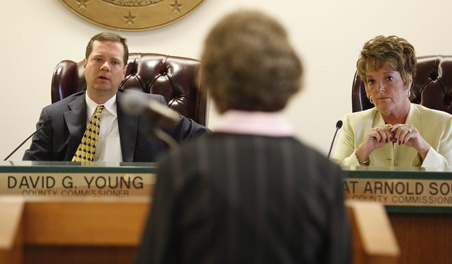 In this 2009 Enquirer file photo, Warren County Commissioner David Young, left, listens during a county meeting.