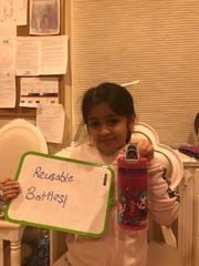 Riya Chaturvedi of Edison displays her reusable water bottle.