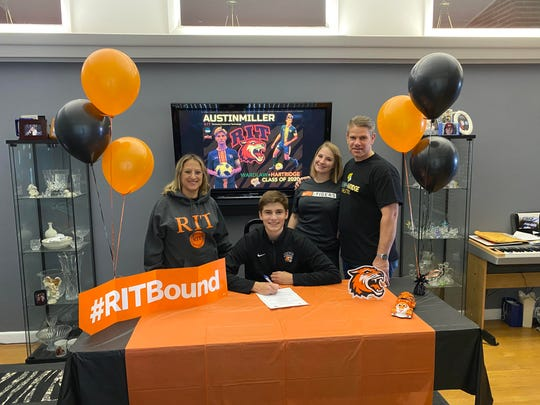 Austin Miller of Linden is joined by his parents, Fatima and Tim, and sister, Aniston, during a virtual signing ceremony in which he made his commitment official to Rochester Institute of Technology.