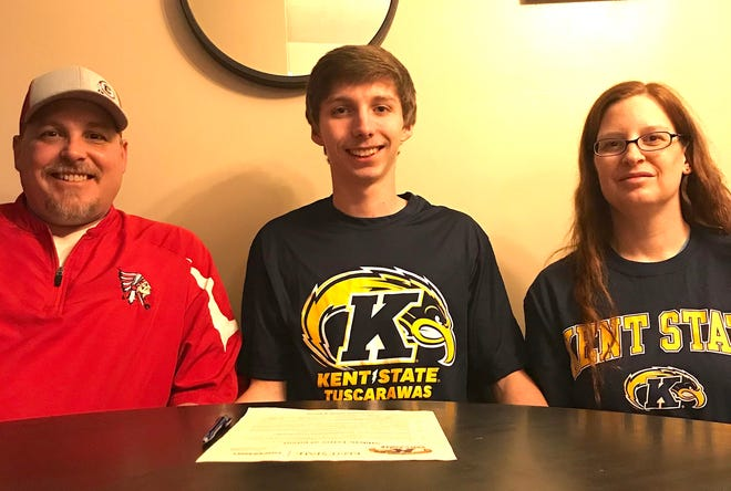 Coshocton senior Gaven Williams (center) signed a Letter of Intent to play basketball for Kent State-Tuscarawas. Pictured with Williams is his father John (left) and mother Chandra (right).