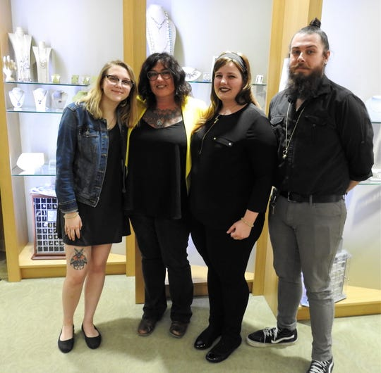 Lyric Turner Ganz, Michelle Turner Ganz, Quinn Moody and Cole Moody at Dean's Jewelry in Coshocton, which Cole works at and Michelle co-owns. Michelle and Stacey Ganz have been together for 23 years and married in 2015. The children said having two moms was never issue and the Coshocton community has always been accepting of their unique, blended family.