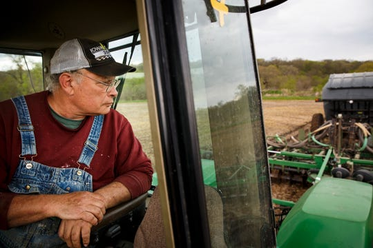 "Jim Greif looks back over his tractor as he tills one of his fields in Linn County on Wednesday, May 6, 2020. ""Farmers are optimists or you wouldn't be farming in this day in age,"" he said. Despite having half of last years crop still in bins, Greif said he is planting because, ""it is what we do."""