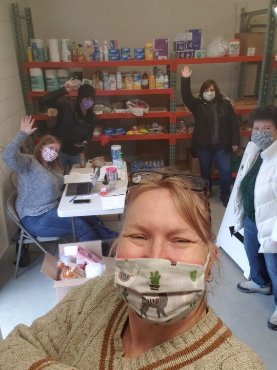 Amanda Stein, front, is pictured here with fellow volunteers at a Madison Heights food pantry she helped found to feed those in need during the pandemic.