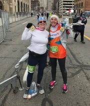 Sandy Humbach, left, and her daughter, Jennie, after running the Free Press marathon.
