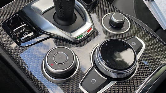 The Stelvio's center console has repositioned switches and improved components.