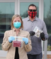 Pamela Lynn and Community Services Coordinator for Oak Park, Robert Koch, handed out masks to the public on April 27, 2020 at the Oak Park Public Safety building.