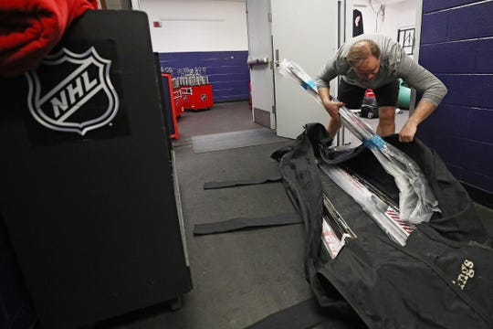 Paul Boyer packing the sticks as part of his duties as head equipment manager for the Detroit Red Wings.