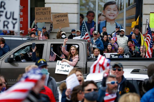 In this April 20, 2020, file photo, protesters demonstrate at the state Capitol in Harrisburg, Pa., demanding that Gov. Tom Wolf reopen Pennsylvania's economy even as new social-distancing mandates took effect at stores and other commercial buildings.