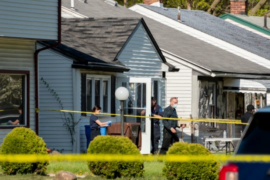 Investigators search a home on John Daly near Lehigh, in Inkster on May 6, 2020. A young boy was found stabbed to death in the home.