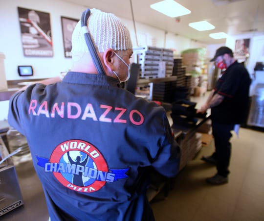 Owner and award-winning pizza-maker Shawn Randazzo, left, of Macomb Township, and co-owner/chef Joe Maino, of Ypsilanti, make pizzas, Wednesday. Shawn became a member of the World Pizza Champions Team in 2014 after he won the 2012 World Pizza Champions in Las Vegas.