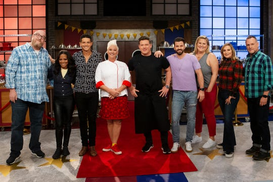 "Mentors Anne Burrell and Tyler Florence pose with recruits Brian Posehn, Robin Givens, Wells Adams, Johnny Bananas, Bridget Everett, Sonja Morgan and Dave Coulier, as seen on the new season of ""Worst Cooks in America,"" premiering Sunday."