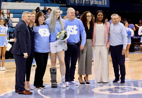 Emily Sullivan pictured with her family and UNC coaches on Senior Night.