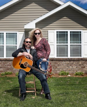 "Musician Gregory ""Cheese"" Allen of The Spread and Kimmer Christensen take an intermission outside their Howard home on May 6. The couple started ""Cheese's Lockdown Livestream"" with performances twice a week while music venues are closed due to the coronavirus pandemic."
