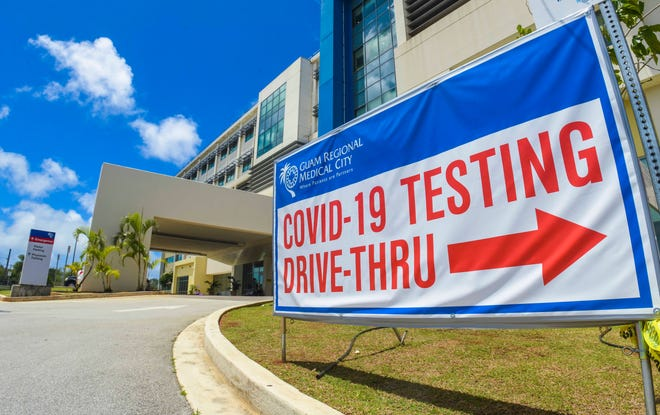 One of several signs direct drivers and their passengers to a drive-through coronavirus testing site placed near the emergency room entrance of the Guam Regional Medical City facility in Dededo on Wednesday, May 6, 2020. The service, is available to everyone including GRMC patients and the public, but applicants will need a referral from their doctor to have the test performed at the hosptial, according to Cindy Hanson, GRMC communication & social media specialist.
