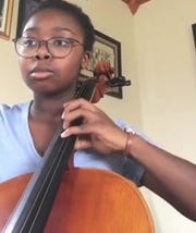 "Alice Doresca practices her cello in her home in isolation like other members of Cadenza Music Club of West High School. Here she performs Vivaldi's ""Cello Sonata in E Minor"" for a video posted by the club on one of several social media sites."