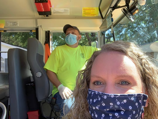 Greg Mills, Forrest County School District bus driver, and Somer Dearman, Rawls Springs Elementary School teacher, mask up as they prepare to deliver meals to the children of the district while school is out during spring semester due to the coronavirus. The meal program will continue in some  fashion over the summer, according to Superintendent Brian Freeman. Details are being worked out.