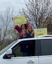 Amelia DelCorvo, top left, Kylyn DelCorvo, bottom left, and Briella DelCorvo show their support for UPS workers with homemade signs outside the distribution center Wednesday morning.