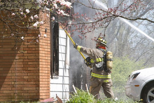 Firefighters from Howell and Brighton fire departments get a fire under control Wednesday, May 6, 2020 in the 2700 block of Dutcher Road in Marion Township.