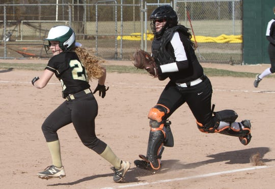 Brighton catcher Alexa Lamoreaux (right) would have played her fourth season on the varsity this spring.