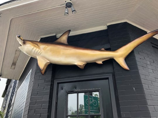 A Hammerhead shark now hangs outside of what was Migo.