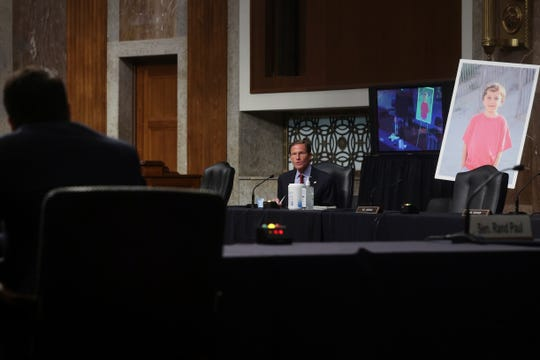 Sen. Richard Blumenthal, D-Conn., questions Judge Justin Walker, while a photo of a young constituent from Ridgefield, Conn., named Conner Curran, who Blumenthal said suffers from muscular dystrophy and was helped by the Affordable Care Act known as Obamacare, is displayed during a Senate Judiciary Committee hearing on Walker's nomination.