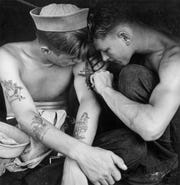 Tattooed sailors on USS New Jersey.