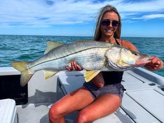 Whitney Leibold  visiting from Alabama,with a nice snook guided by Capt Christian Sommer.