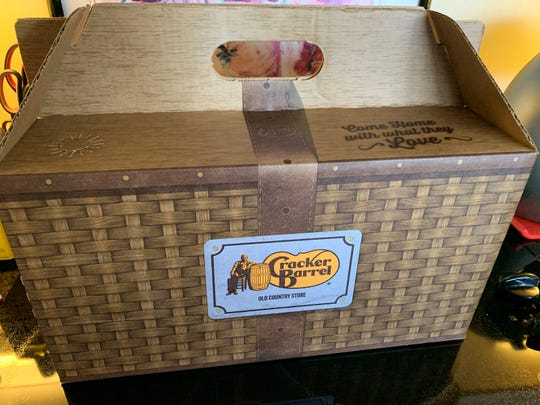 The carryout box for family meal deals at Cracker Barrel, Naples.