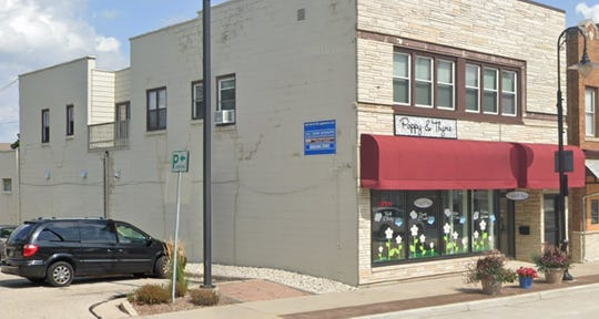 Menomonee Falls' Poppy & Thyme will sport one of the murals for the downtown business improvement district's mural project. Six artists will paint the murals, which should be completed by the end of the year.