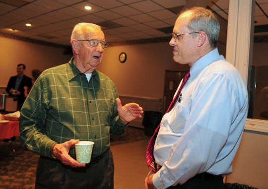 Wharton, Nov. 23, 2012 -- Cliff Back, a coach and track official, talks with Jay Thomson of Randolph, class of 1982 and one of the organizers of the event. Former teammates and plenty of runners assemble at the American Legion Hall as Dover High School's cross country team celebrates its 75th year with a reunion. Guest of Honor Wayne Valentine celebrates his 50th anniversary as a cross country coach.  By Karen Mancinelli For the Daily Record MOR 1124 Valentine